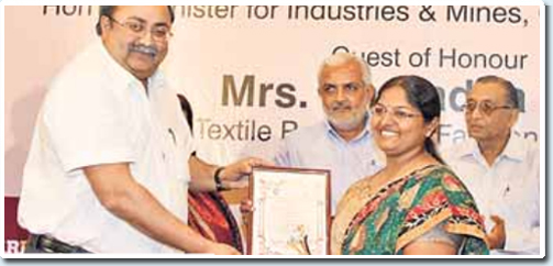 shreedevi harikrishnan recieving award
